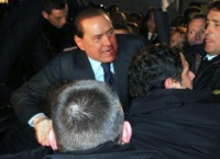 Нападение на С. Берлускони.